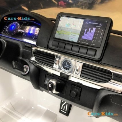 Электромобиль LEXUS LX 570 белый (легко съемный аккумулятор, 4WD, 2х местный, колеса резина, сиденье кожа, пульт, музыка)